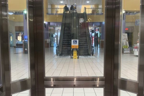 elevator cab in mall with a view of the escalators